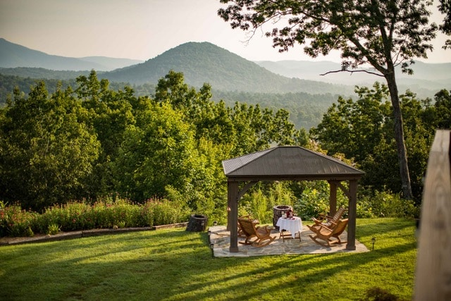 The Inn's Gazebo with views of mountains in the background.