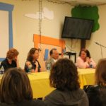 One of the panel discussions featuring several authors at a table.