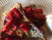 Red strawberries with french toast and a dollop of better on the side