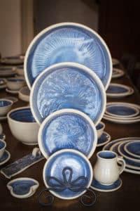 A set of blue handmade stoneware dinnerware.