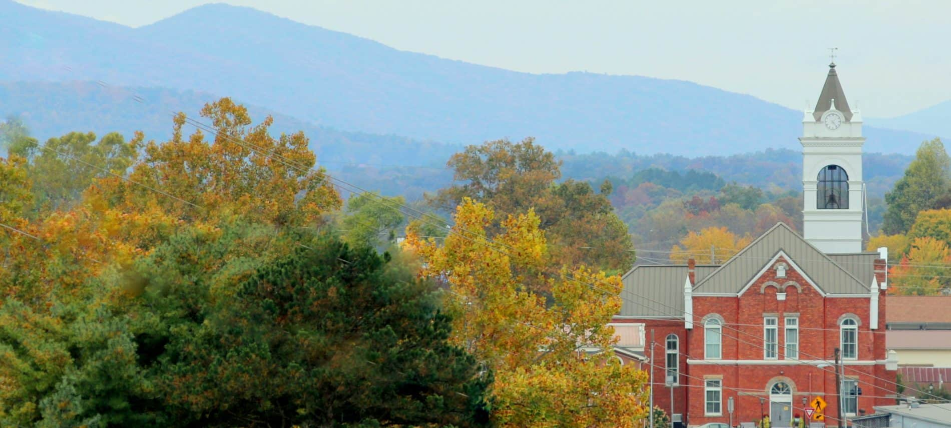 Pretty postcard scene of Blairsville downtown in autumn of a church . Title: Blairsville, Georgia,