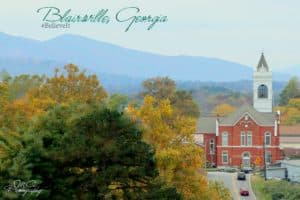 Pretty shot of Blairsville with mountains behind and the downtown in forefront.