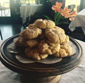 A stack of gooey butter cookies on a plate.