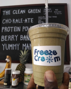 Freeze Cream smoothie presented in front of a menu board.