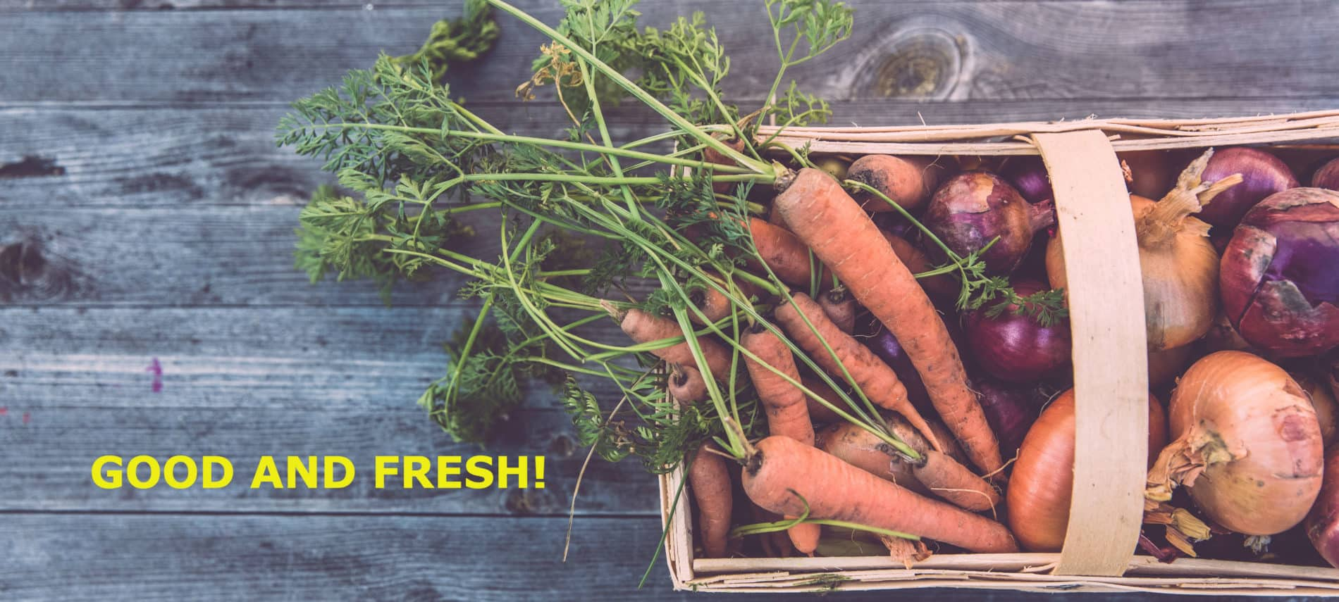 A rustic basket filled with fresh garden carrots.
