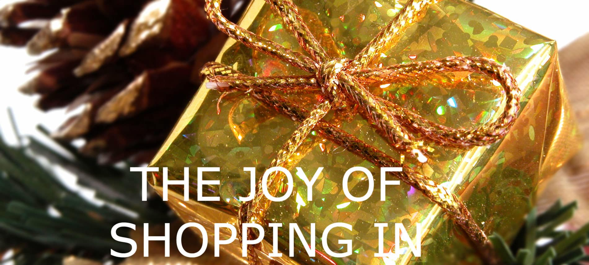 "Gold gift box with title over it, ""The joy of shopping in the mountains."""