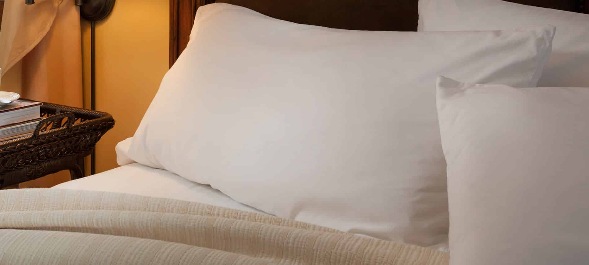 Three white pillows at the top of the bed