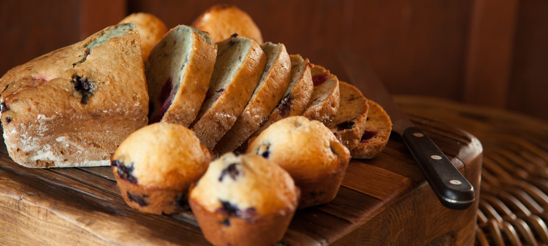 yummy mouth watering blueberry muffins and bread all sliced and ready to be eaten