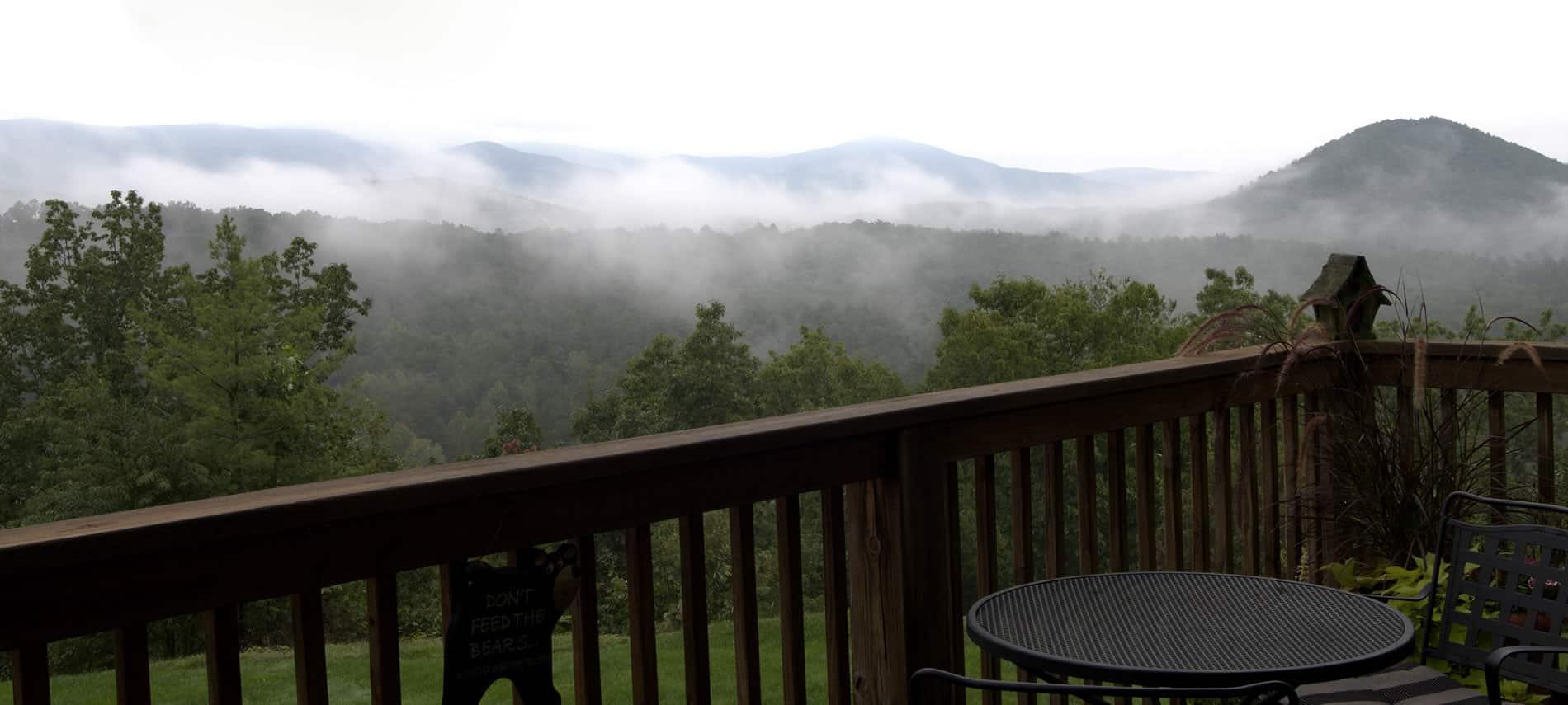 Overlooking the mountains with morning fog from the deck