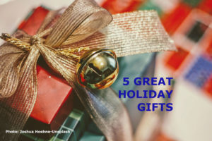 Red paper wrapped gift with gold ribbon and title: 5 great holiday gifts