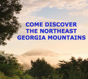 """Photo of clouds hovering over the mountains with title, """"Come discover the Northeast Georgia Mountains."""""""
