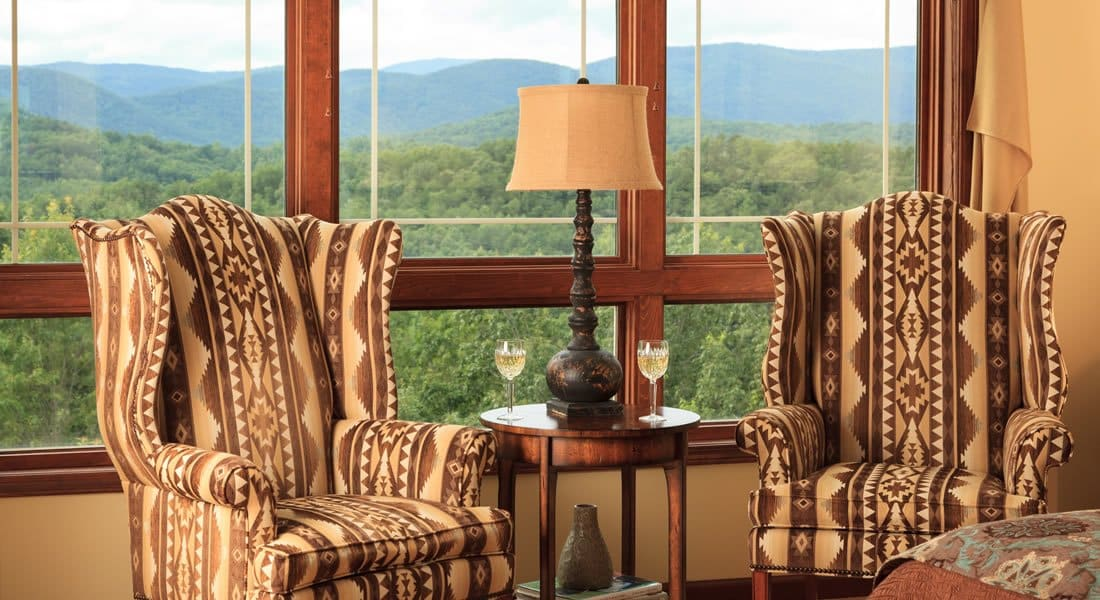 Two Astec tall back chairs infront of three windows with an incredible view of the mountains.