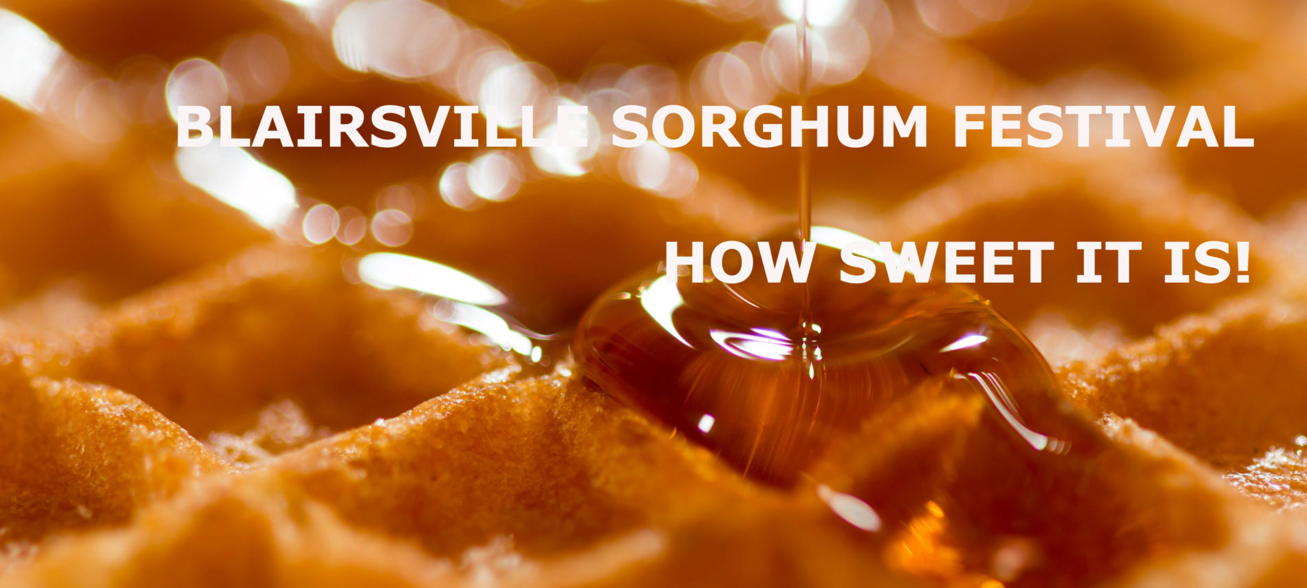 Golden syrup pouring in a thin stream onto a crisp waffle. Title: Blairsville Sorghum Festival. How Sweet It is!