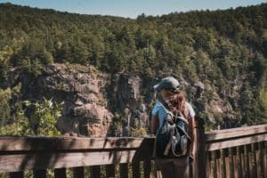 A woman standing at an overlook at Tallulah Gorge State Park