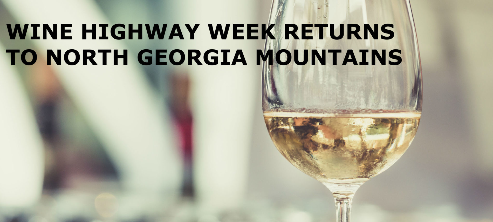 "Stemmed glass with white wine. and background is blurred out. Title: ""Wine highway week returns to north georgia mountains"""
